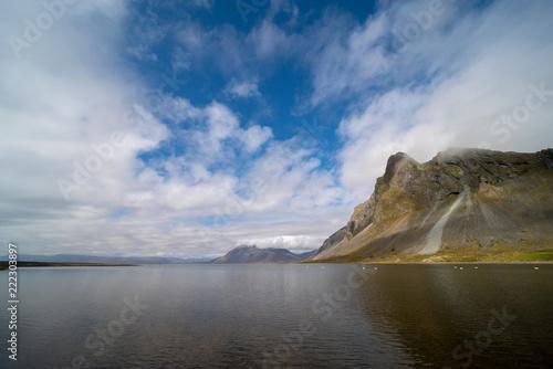 Sea coast with mountain reflection, Iceland