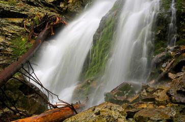 waterfall among green wet stones