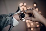 Stylish white watch on woman hand