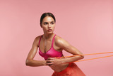 Workout. Woman Training With Resistance Bands On Pink Background - 222317870