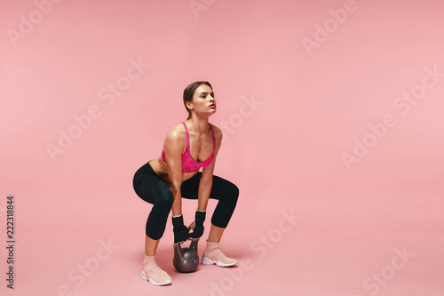 Foto Murales Sport Training. Athletic Woman Doing Squats With Dumbbell