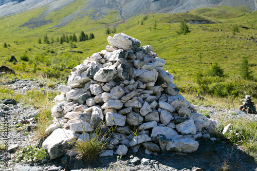A mountain of marble stones. Marble stones are built up by a mountain, a sacred place of worship of pagans. - 222320472