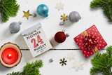 christmas decoration on wooden background and tear off calendar with the 24th of december 2018 on top