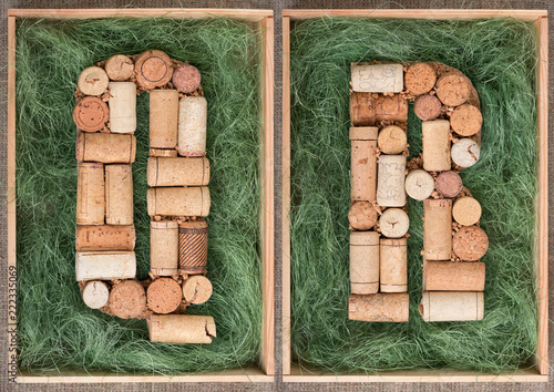 Foto Murales Alphabet letter Q and  R made of  wine corks on green background in wooden box. ABC set