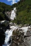 Waterfall at a pass road in Austria in early autumn   - 222340201
