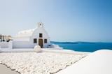 White church in Oia town, Santorini island, Greece. Beautiful summer landscape, sea view.