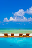 Loungers and pool on Maldives beach - 222341043