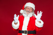 Leinwanddruck Bild - Christmas. Good Santa Claus in white gloves shows faces, grimaces, shows his tongue. Not standard behavior. Isolated on red background.