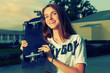 Happy redhair teen with skateboard