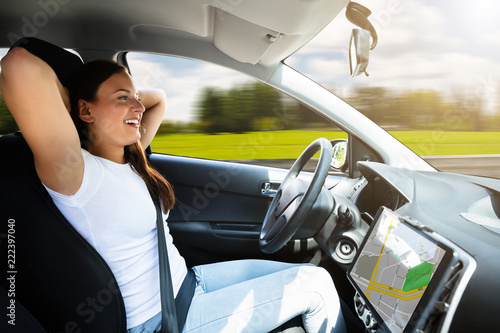 Wall mural Woman Sitting In Self Driving Modern Car