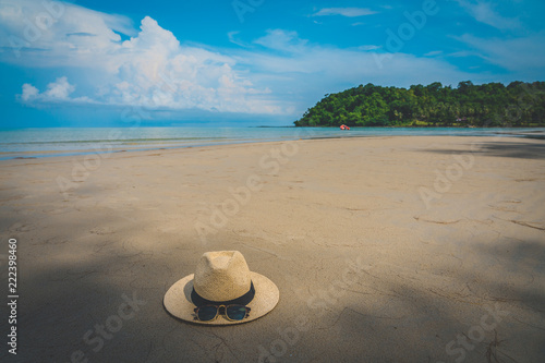 Beautiful Tropical Beach blue ocean background with Traveler items  vacation travel accessories for holiday or long weekend a guide  choice idea for planning travel - 222398460