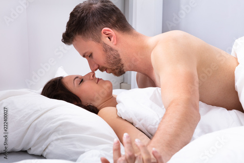 Couple Lying On Bed - 222400027