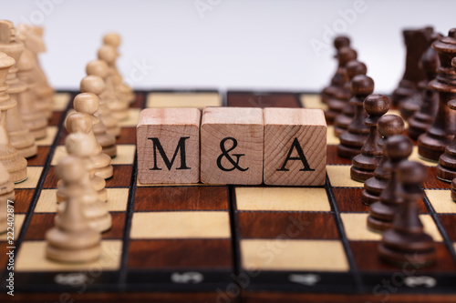 Wooden Blocks With Mergers And Acquisitions Text On Chess Board - 222402877