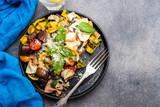 Pasta Farfalle with mushrooms, basil, tomatoes and cream sauce. Italian traditional cuisine. Mediterranean food