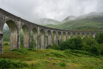 Glenfinnan Viaduct is a railway bridge on the West Highland Line near the top of Loch Shiel in the West Highlands of Scotland © rjcoulstock