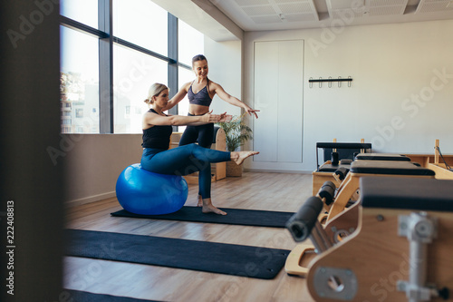 Wall mural Women practicing pilates workout at a gym