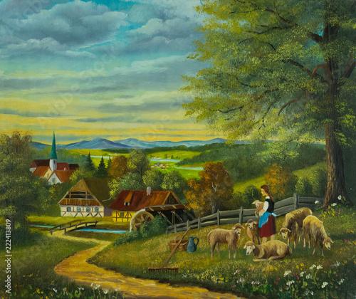 Leinwanddruck Bild Schafe in einer Blumenwiese vor einer Ortschaft
