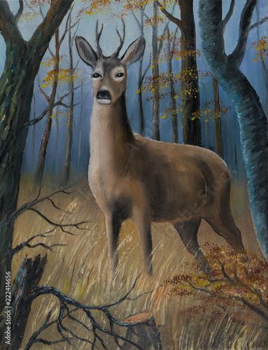 Leinwanddruck Bild Brauner Hirsch steht im hohen Gras zwischen Bäumen