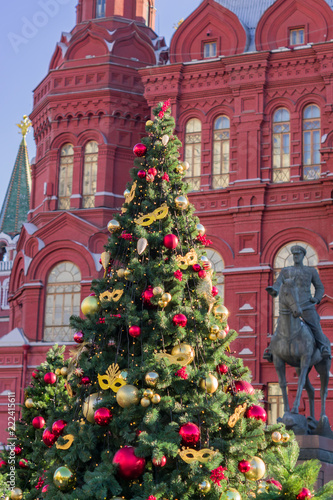 The monument to Marshal Georgy Zhukov and Christmas trees on Historical Museum on Red Square in Moscow, Russia - 222415611