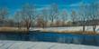 Leinwanddruck Bild - Verschneite Winterlandschaft mit Fluß und Bäumen