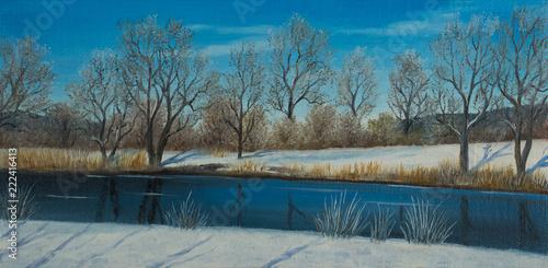 Leinwanddruck Bild Verschneite Winterlandschaft mit Fluß und Bäumen