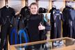 Leinwandbild Motiv Female is standing in full set of  diving equipment