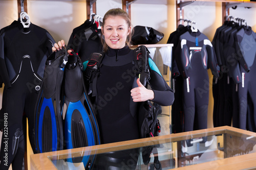 Leinwanddruck Bild Female is standing in full set of  diving equipment