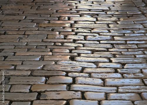 cubblestone walkway in the city - 222420464
