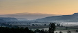 Autumn morning. Breathtaking morning lansdcape of small transylvanian village covered in fog. - 222427478