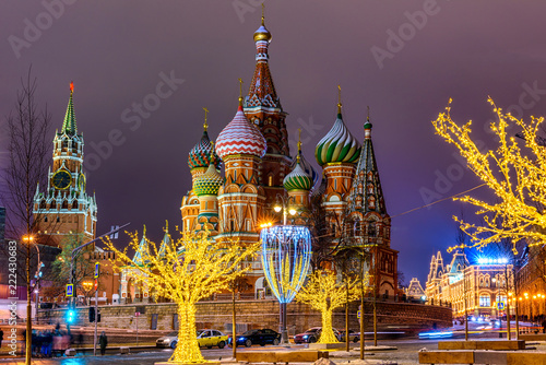 Night view of Spasskaya Tower, Moscow Kremlin and Saint Basil s Cathedral in Moscow, Russia. Architecture and landmarks of Moscow. Moscow with Christmas decoration.