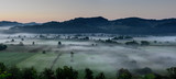 Agricultural Field. Foggy morning over rural countryside landsacpe. - 222430820