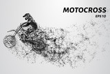 Motocross particles. A motorcyclist performs stunts
