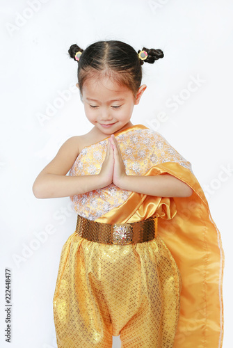 c24b8b337 Cute Asian child girl in traditional thai dress praying isolated on white  background.
