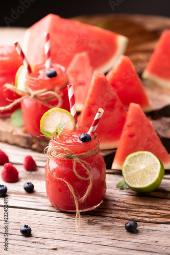 Foto Murales Water melon smothie on wooden table