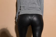 Woman's ass in black leather pants