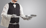 Waiter serving with white gloves and steel tray in an empty space  - 222452651