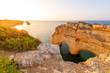 Heart shaped arch rock on Ocean, Algarve beach and coastline. Portugal