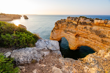 Heart shaped arch rock on Ocean, Algarve beach and coastline. Portugal