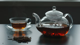 Teapot, tea crop and glass cup are near - 222465237