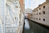 Bridge of Sighs, wide angle view with statue in a calm morning in Venice, Italy