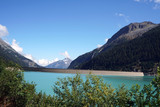 High situated reservoir in Austria with mountains in the background  - 222495240
