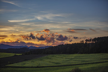 sunset over the green hills