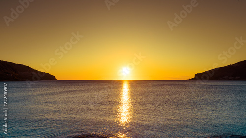 Foto Murales Sunset or sunrise over sea surface