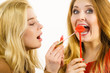 Two women and lip product