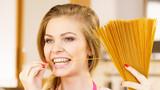 Woman holding long pasta