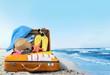 Leinwanddruck Bild - Retro suitcase with travel objects  on hotel background