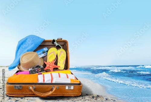 Leinwanddruck Bild Retro suitcase with travel objects  on hotel background