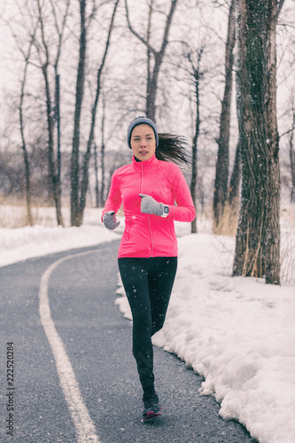 ff236f3a0ee29 Winter exercise Asian woman running in cold weather clothes. Chinese runner  girl training outside.