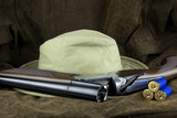 Shotgun and Cartridges with Hat on Outdoor Coat - 222528208