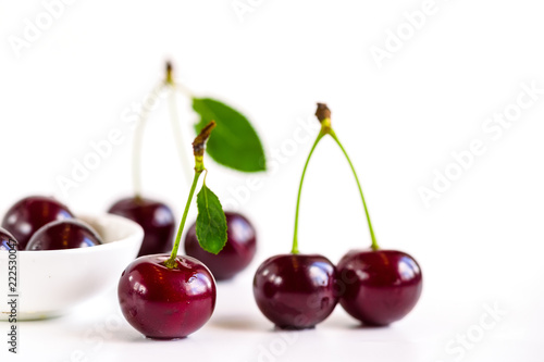 ripe cherries on a white background - 222530047